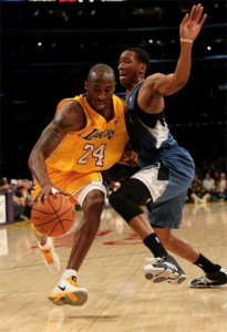 Kobe Bryant drives to basket against Timberwolves.