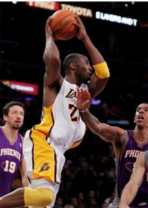 Kobe Bryant looks to pass against Suns.