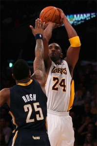 Kobe Bryant shoots over Brandon Rush.