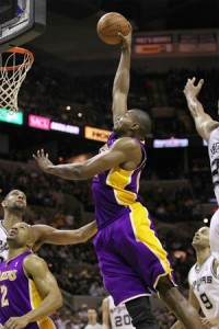 Andrew Bynum slams home two against Spurs.