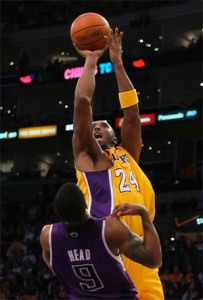 Kobe Bryant scores two over Luther Head.