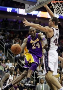 Kobe Bryant dishes off for two against Nets.