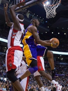 Kobe Bryant reverses home two against Raptors.
