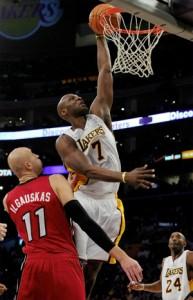 Lamar Odom slams home two against Heat.