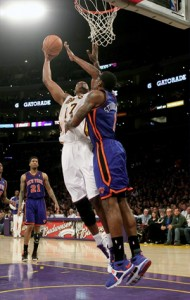 Andrew Bynum rises up for dunk against Knicks.