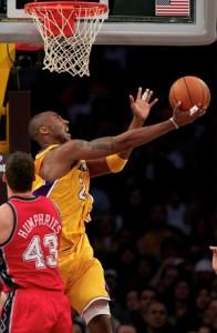 Kobe Bryant makes circus shot against Nets.