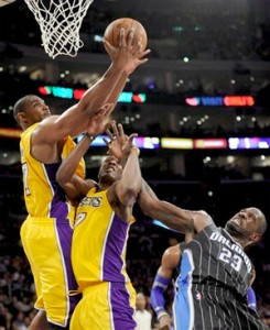 Andrew Bynum grabs one of his game-high 18 rebounds.