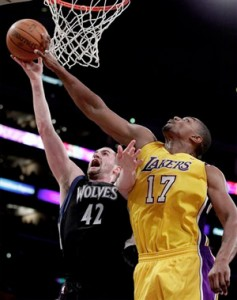 Andrew Bynum blocks Kevin Love's shot.