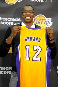 Dwight Howard shows off new Lakers jersey at press conference.