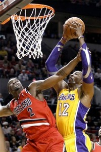 Dwight Howard is fouled as he goes up for a dunk.