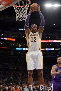 Dwight Howard powers up for two against Kings.