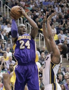 Kobe Bryant looks to shoot against Jazz.