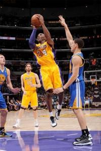 Kobe Bryant takes shot against Warriors.