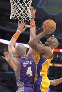 Kobe Bryant fights to get shot up against Phoenix.